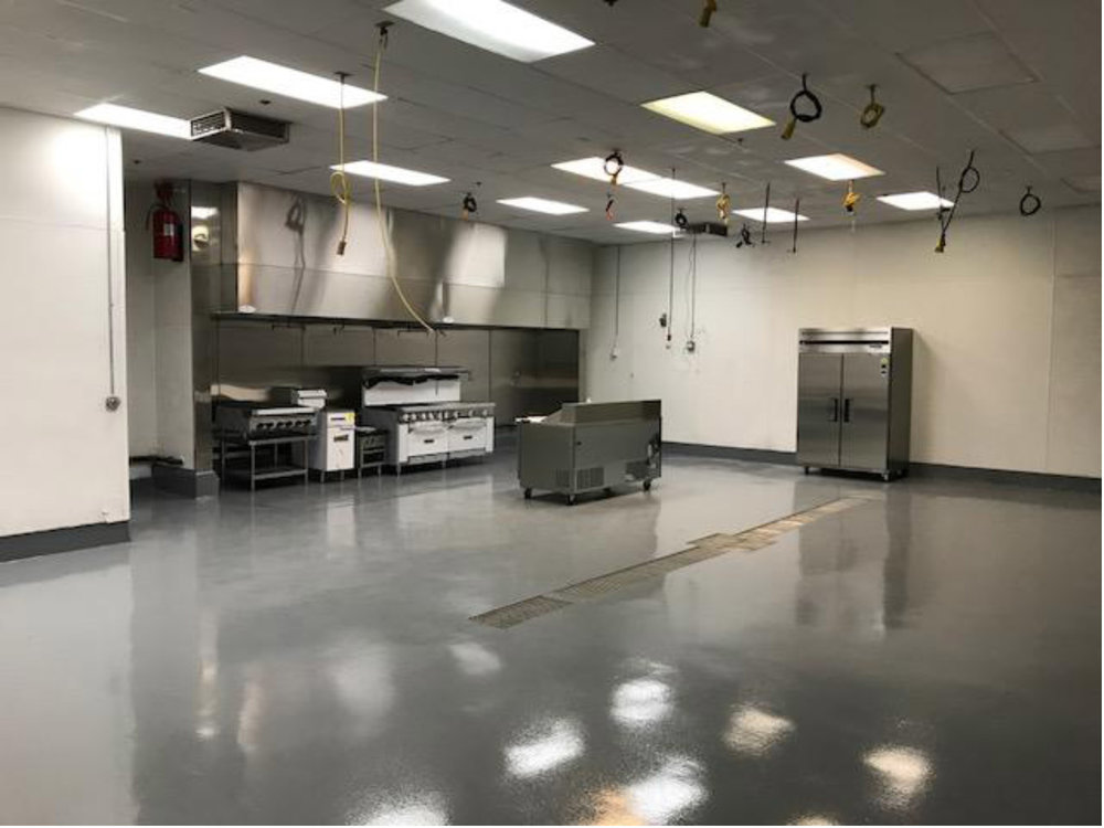Cooking/Food Prep Area With Floor Drains