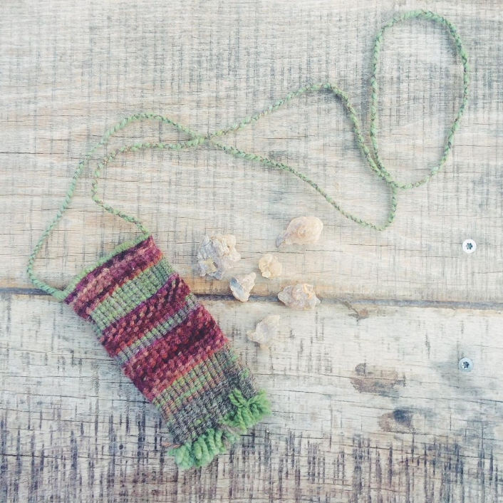 One of the first medicine bags, I made for a dear friend, utilizing nettle dyed yarn. Nettle is known for its nutritive and mineralizing qualities and may provide support for those seeking  balance, nourishment and stability when worn close to the heart. Circa 2015