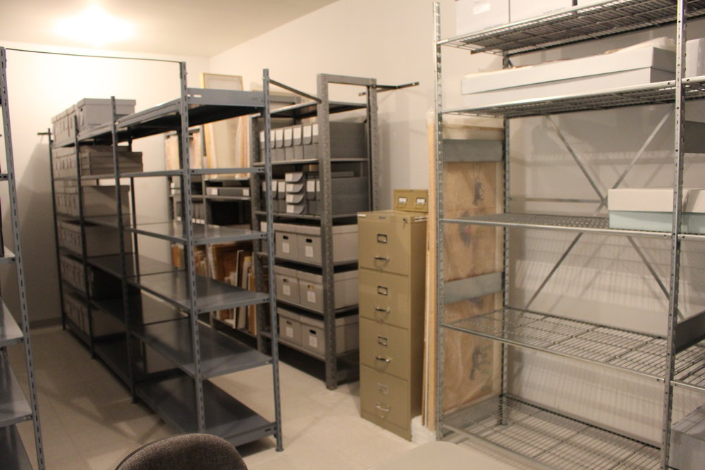 Everything was rehoused into proper storage boxes. Oversized items were moved to the new, wider shelving units. We saved a lot of space by compiling the items into upright acid-free file boxes.