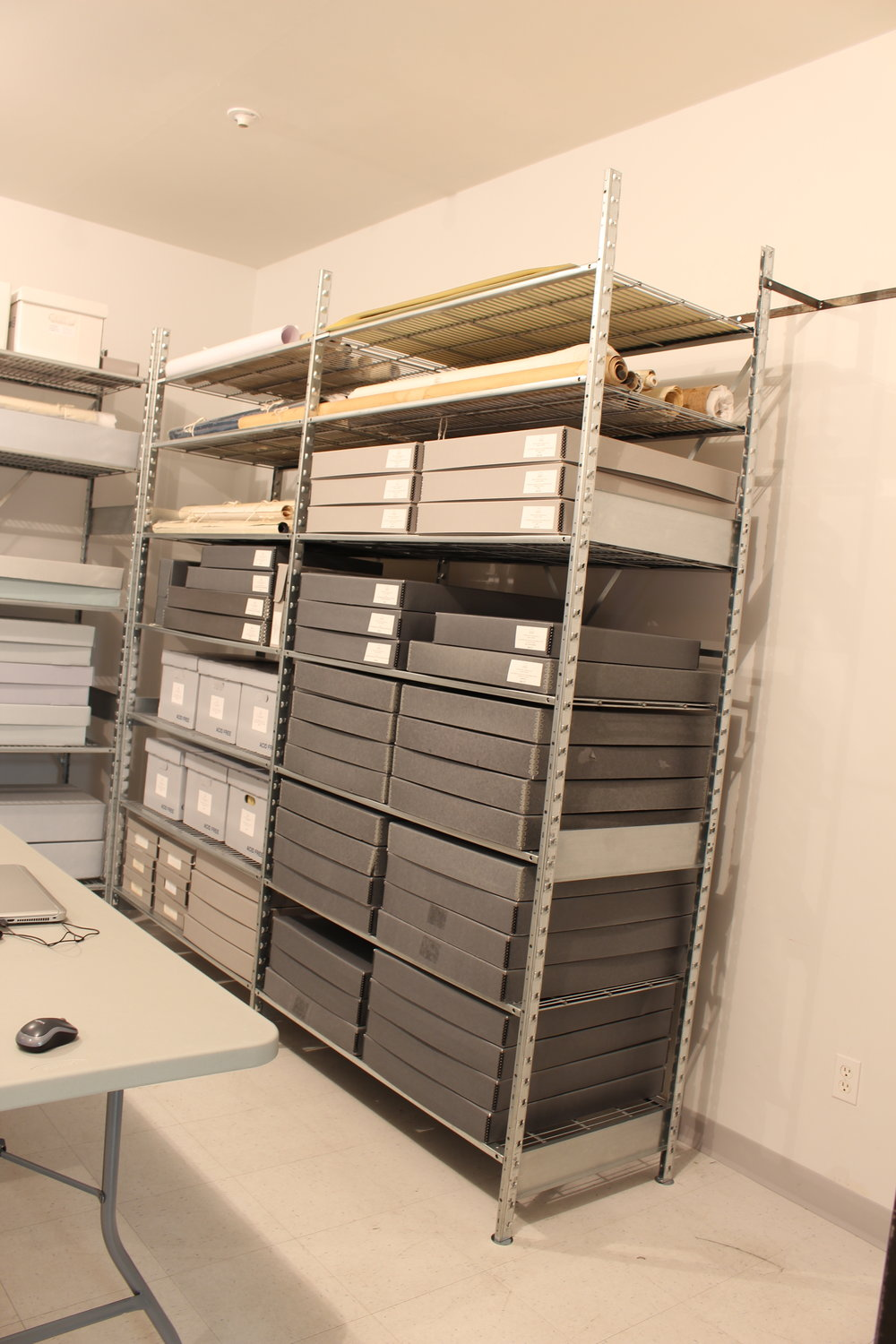 These extra-wide shelves now hold all of the wide collection items - newspapers, scrapbooks, rolled maps, and oversized documents. Nothing overhanging anymore!