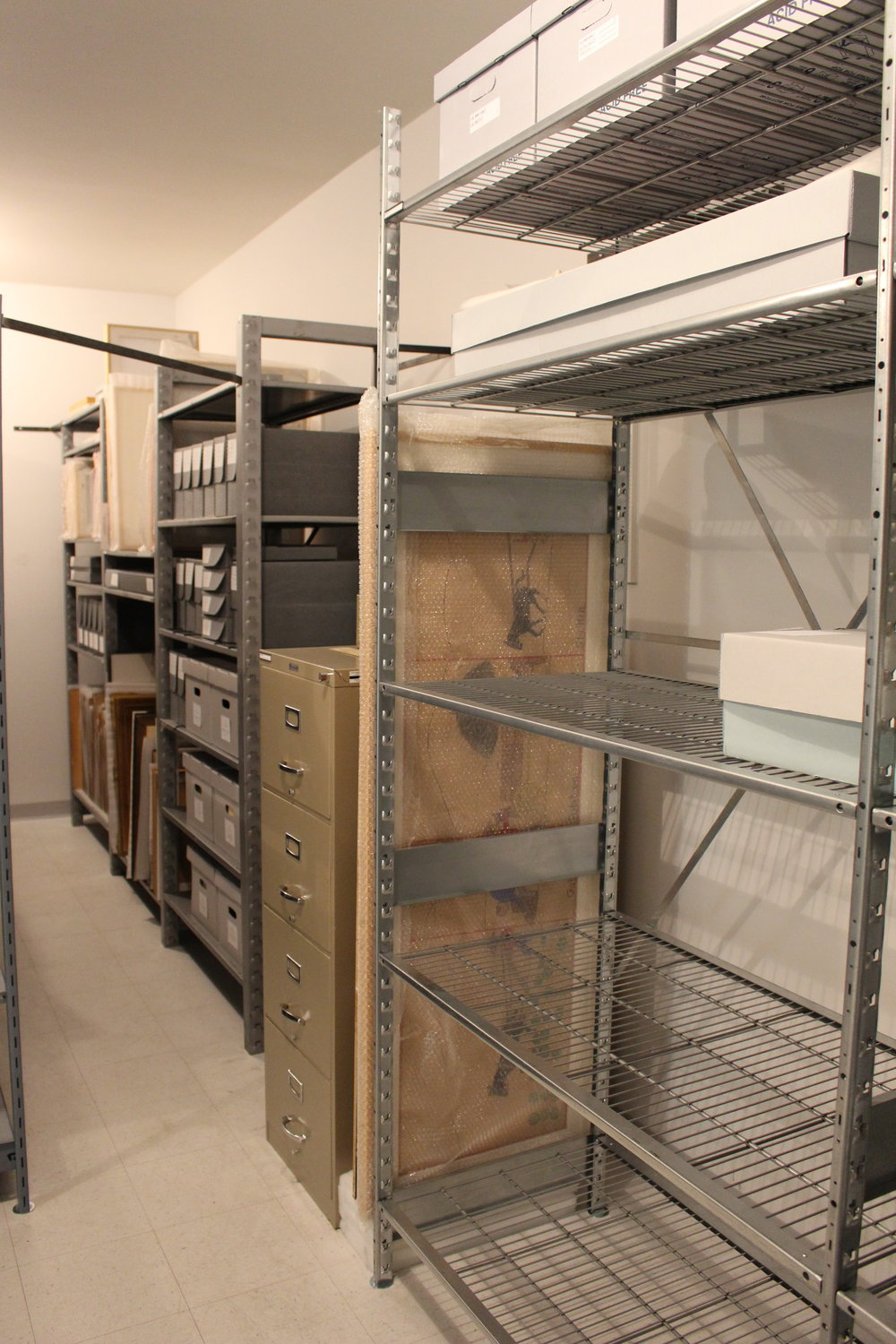There's now no more acidic or chemically-damaging materials in the archives. We replaced wood shelves with metal ones, cardboard with acid-free archival storage, and even tested all of the tissue used to protect our photograph collection.