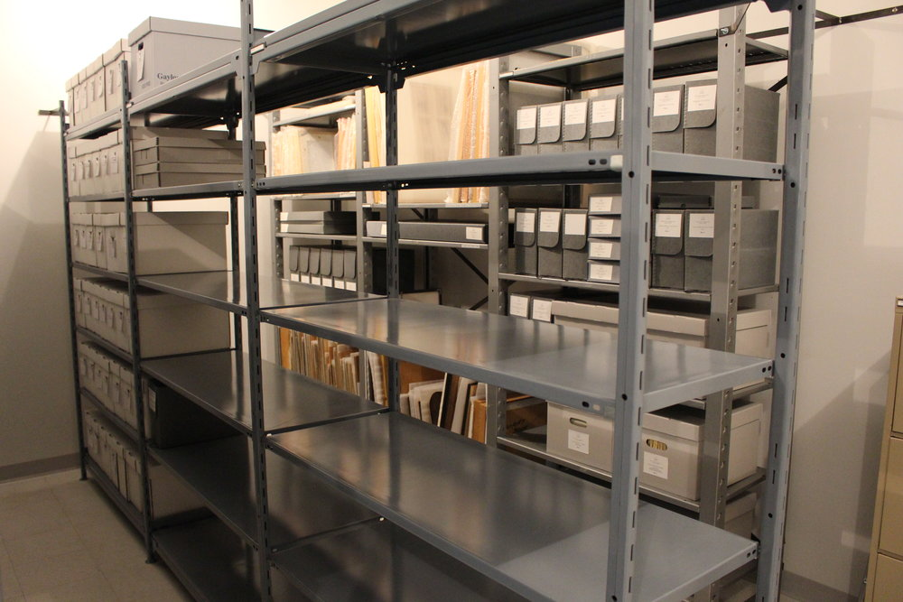 Artifacts were taken to the Museum, and framed items, scrapbooks, and newspapers were rehoused on the wide shelving. Look at all that space!