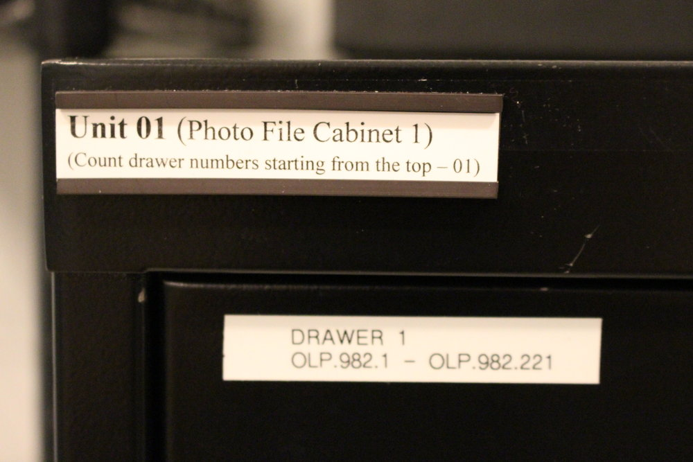 Cabinets and shelves are all assigned a Unit number and given a description. Every shelf or drawer in that unit starts at 1 at the top and continues down to the floor - that location is then entered into each item's database entry so we can find it for researchers.