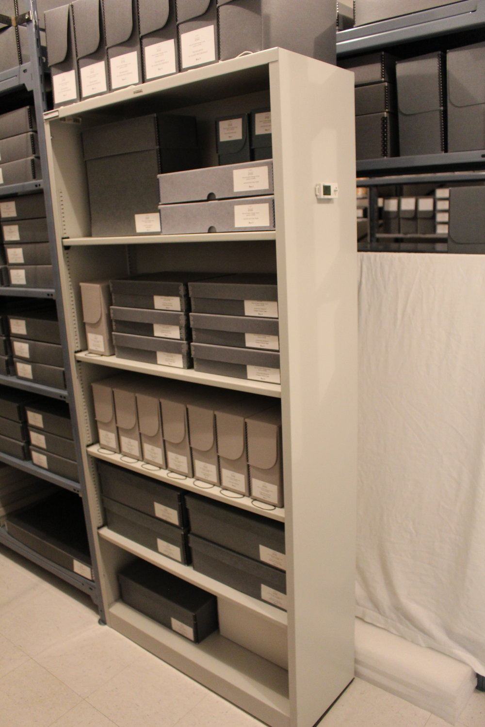 This is where all the audio-visual items are housed now. in boxes, out of the light and dusty atmosphere. Film reels, CDs/DVDs, and cassettes are in boxes that keep them safe from being crushed or scratched. Transcriptions of each item are housed on the top shelf for easy access.