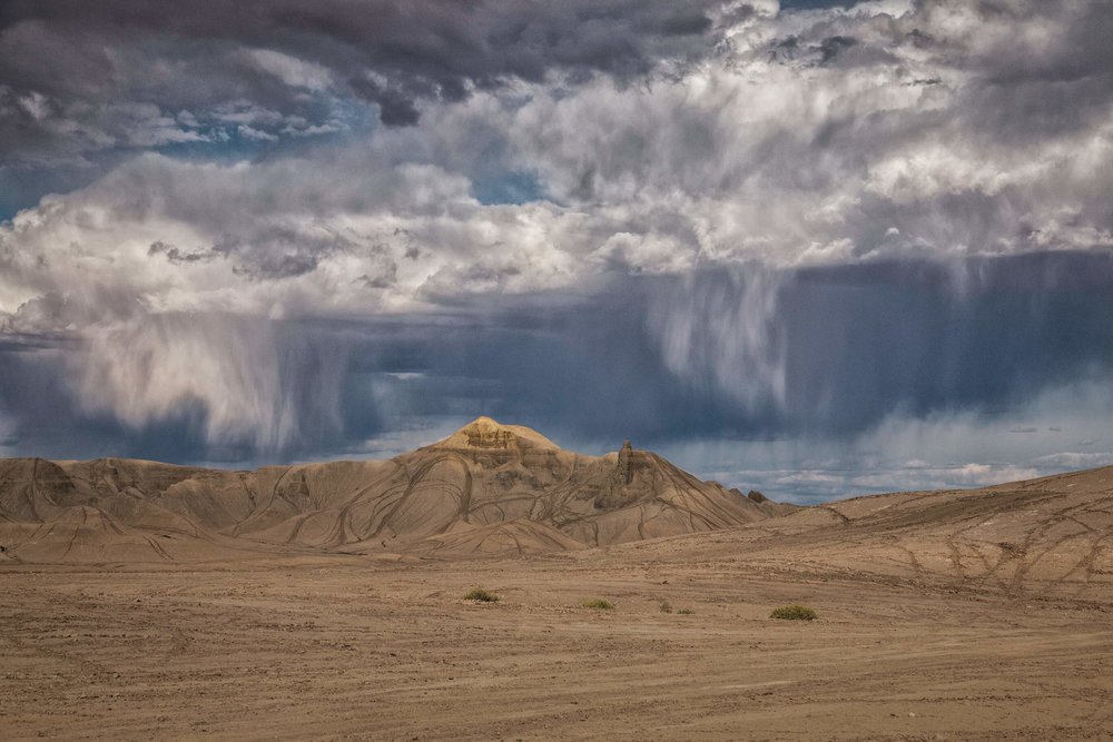 Rainy Stormy Clouds in Grand Staircase-Escalante National Monument - ©️ Nicole Atkins Modern Outdoors