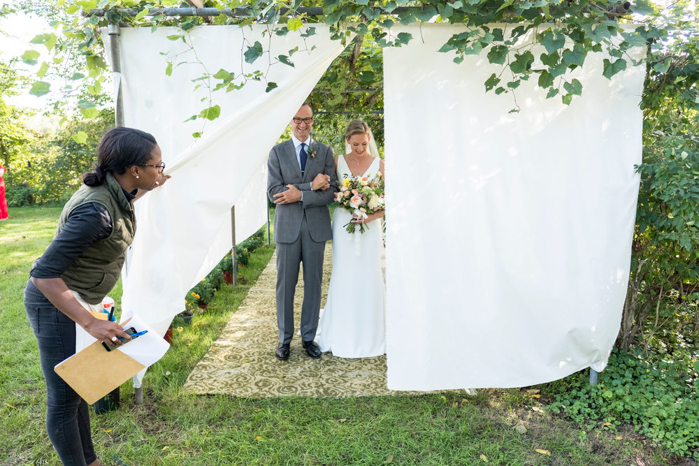Bride and her Father, headed to the aisle! Oh, look who made the photo! Lead Planner, Ty Howard!  Photography by Zachary Hartzell Photography, LLC
