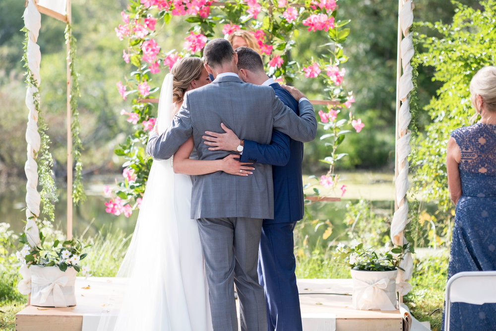 My favorite photo - the moment the Father of the Bride gave away his daughter.   Photography by Zachary Hartzell Photography, LLC