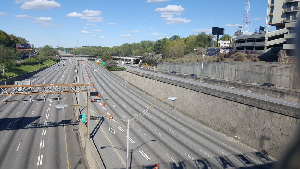 A truly majestic sight: an empty Interstate 85 in midtown Atlanta. This picture was made possible by the mysterious bridge fire of 2017.