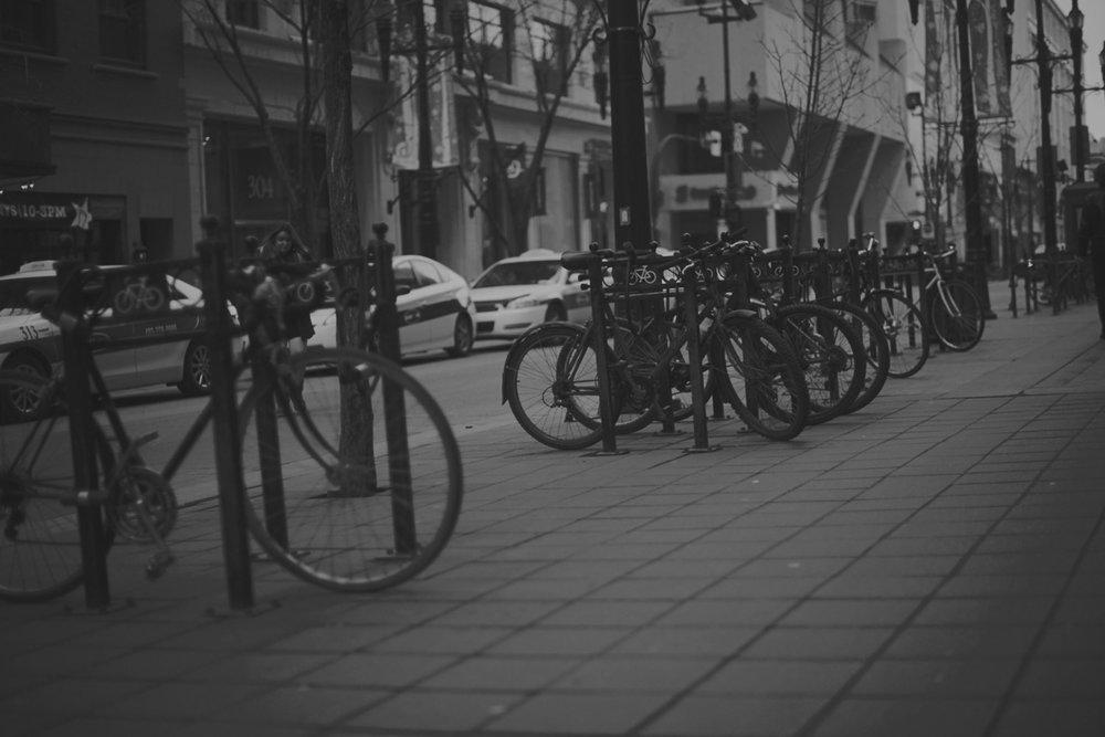 bike parking on the street of Calgary | Badyal Toor Law