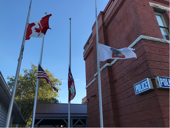 Cobourg Police Flags at Half-Mast.png