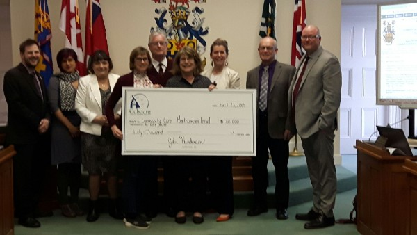 (Front and centre) Northumberland Hospice Care Centre fundraising co-chair Patti Ley and Community Care Northumberland executive director Trish Baird were delighted to accept a $60,000 donation from the Town of Cobourg at this week's committee-of-the-whole council meeting, presented by (from left) Councillors Aaron Burchat and Emily Chorley, Deputy Mayor Suzanne Seguin, Mayor John Henderson and Councillors Nicole Beatty, Brian Darling and Adam Bureau.