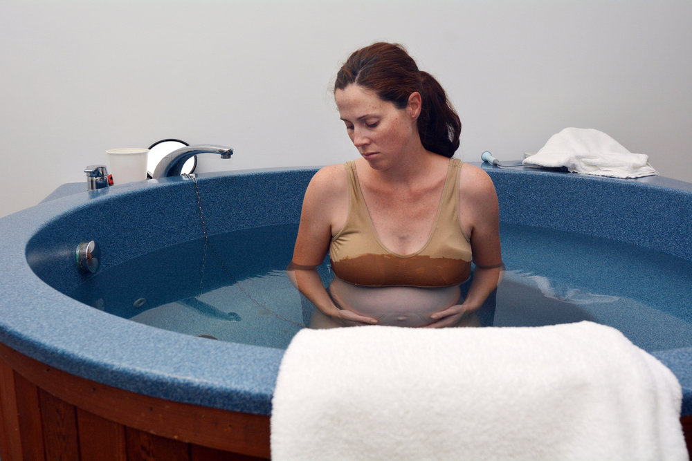 Pregnancy - pregnant woman natural water birth