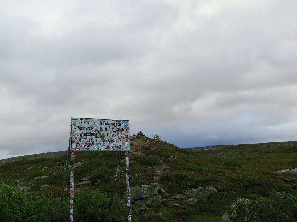 sign marking the entrance to the arctic circle. Add a sticker!