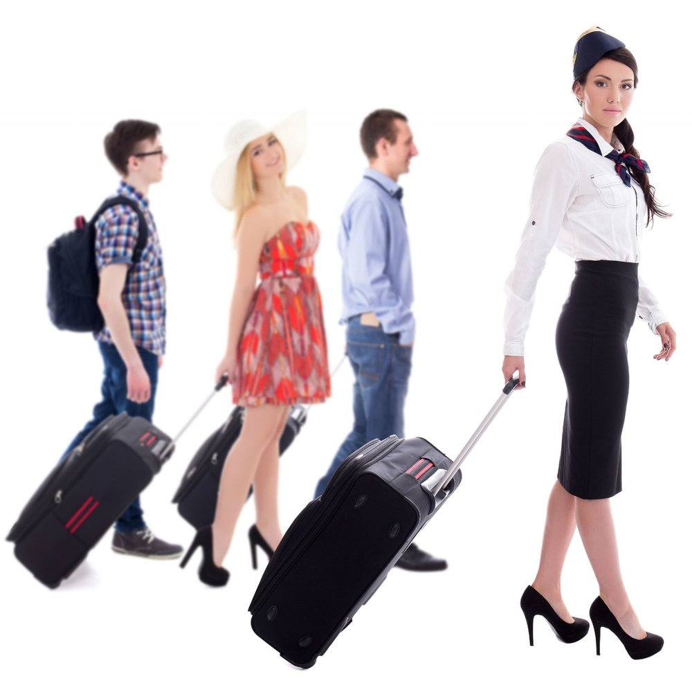 flight attendant with tourists ready to board passenger charter flight.jpg