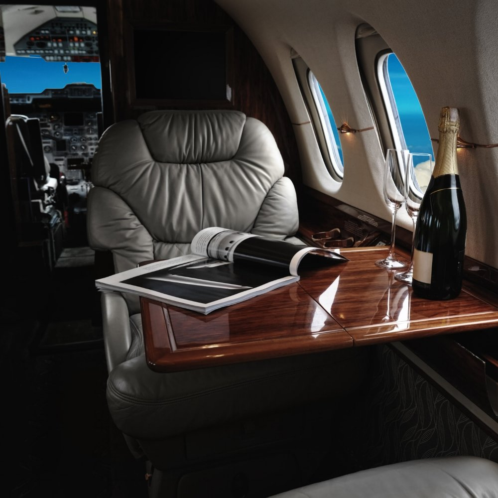 vip luxury flight with champagne and glass on business jet.jpg