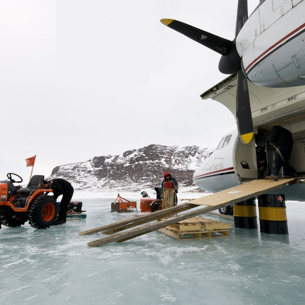 cargo being offloaded from flight in the arctic.jpg