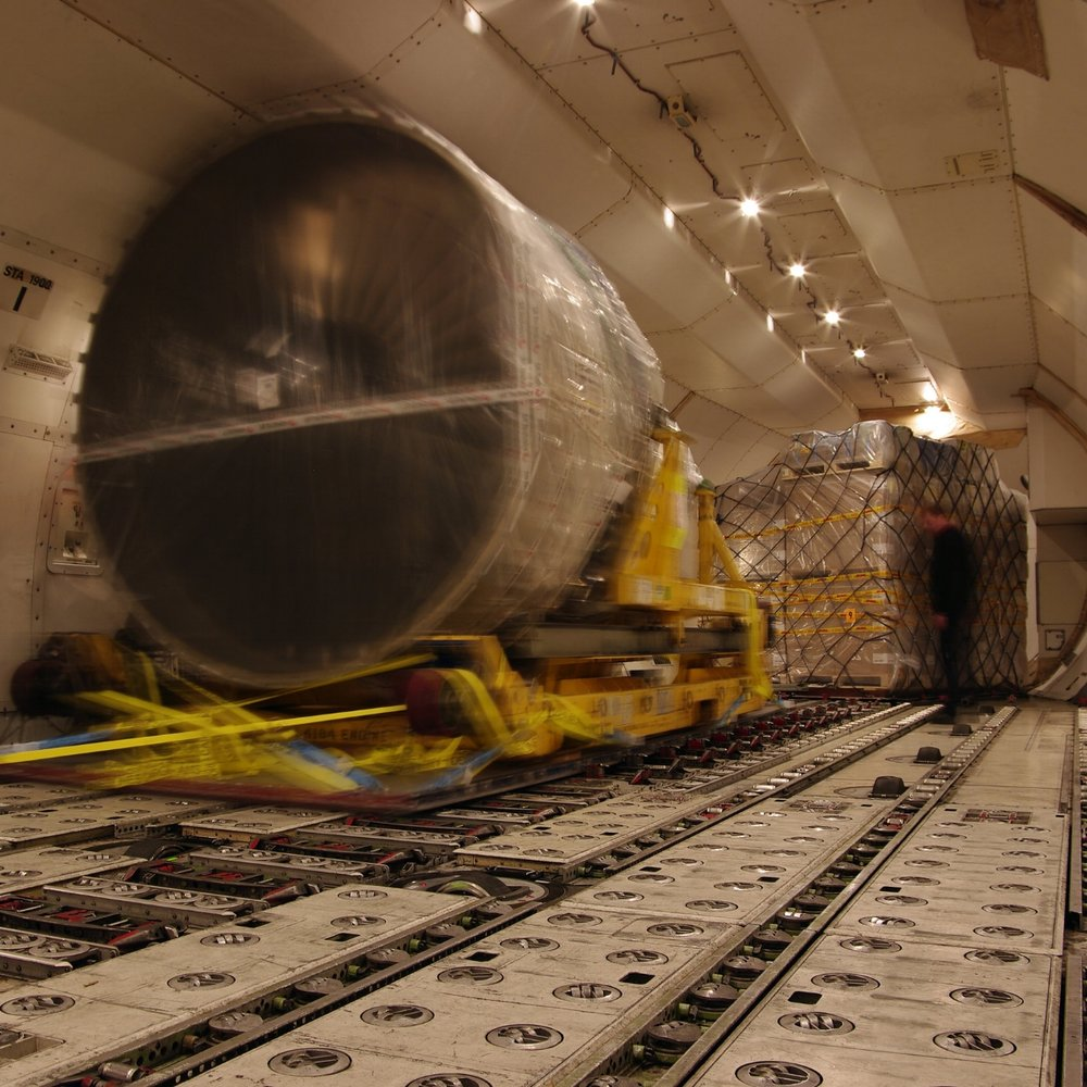 Specialized air cargo being loaded into freighter aircraft.jpg