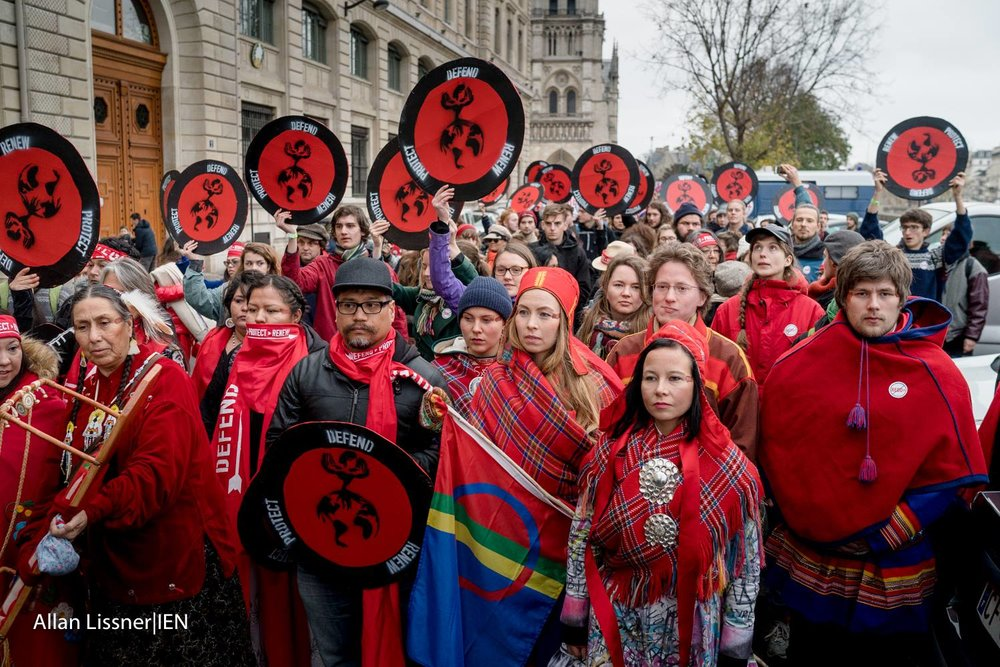 Mobilising on the streets of Paris with the Indigenous Environmental Network and Saami activists from the Arctic circle ( photo credit Indigenous Environmental Network )