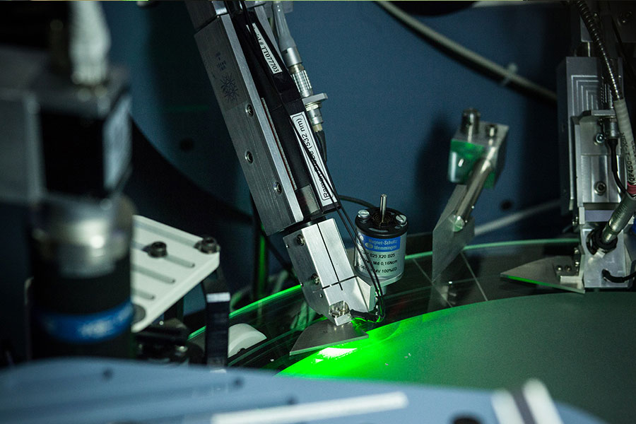 A green laser probe checks for possible diamond imitations