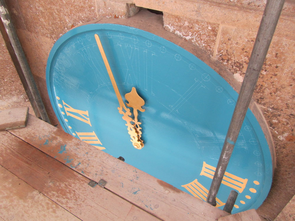 Gilding the clock face