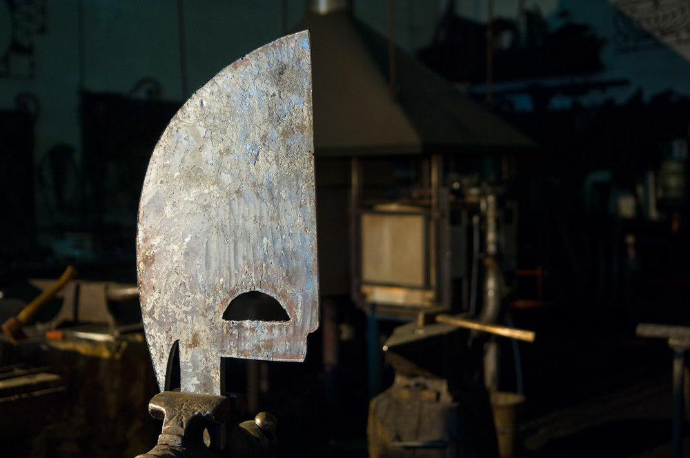 The raw metal piece of the bow of the gondola