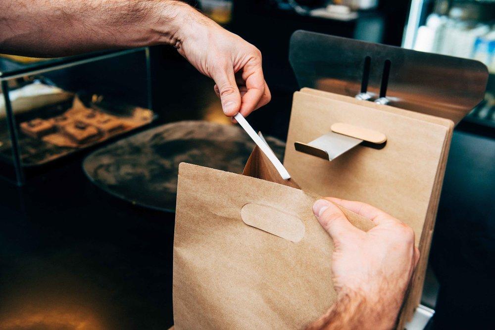 Self-Sealing Paper Bags & Dispenser - Ensuring your food is protected from door to door!