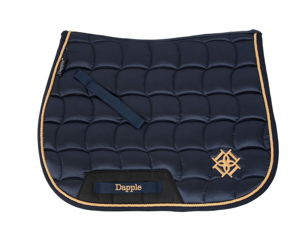 Dapple Navy Saddle Pad with Gold Piping white background.jpg