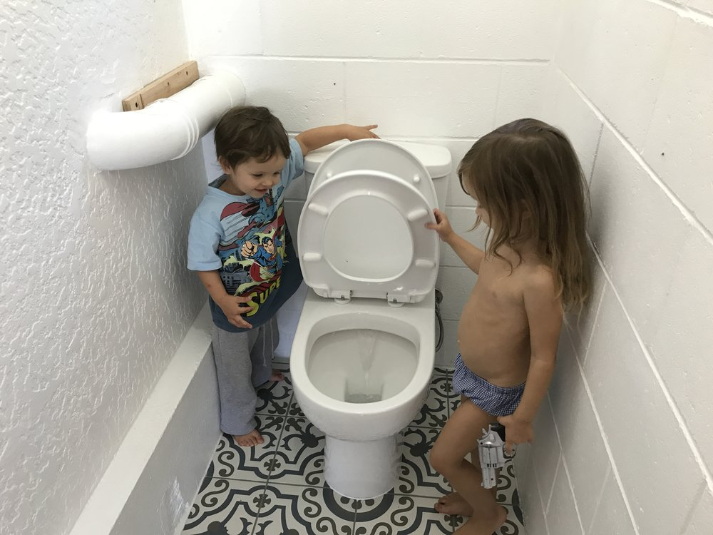 After what seems like an eternity, the toilet is installed and fully functioning. The children are amazed. Their parents are magicians.