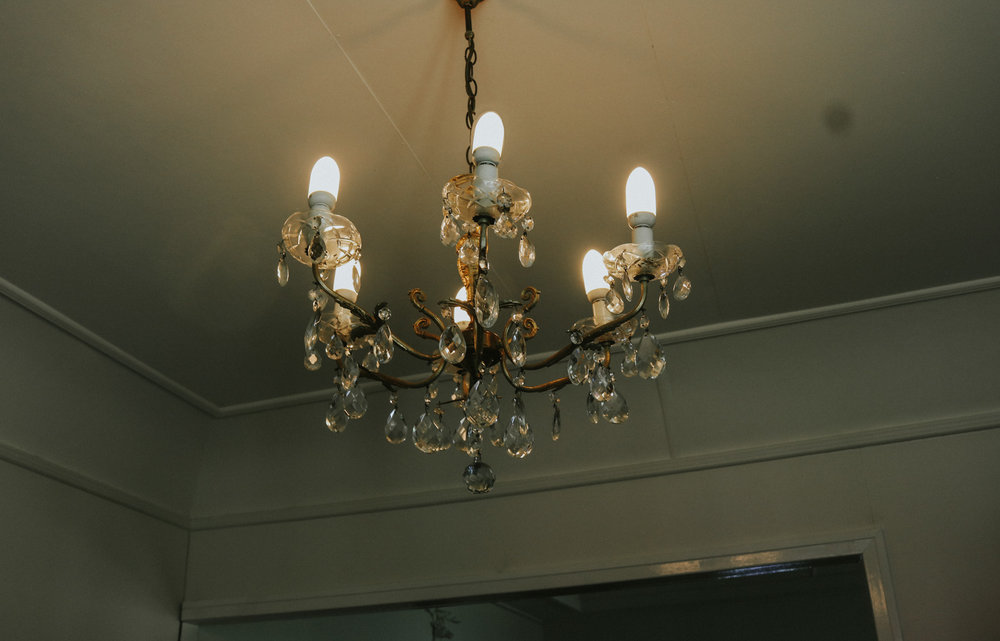 I bought this chandelier off eBay for $19.  It did however cost four times that much in postage to get it up from Sydney but for $100 all up, I still consider it a bargain and much nicer than the old fluorescent wall light pictured below. As I said earlier, the plan is to make this the dining room eventually so the chandelier will hang over the dining table.