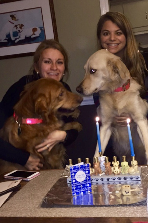 "Emily Levinson (on right) with friends - Aly (on left), Bella and Abby (the furry ones) - celebrate a ""golden"" Chanukah!"