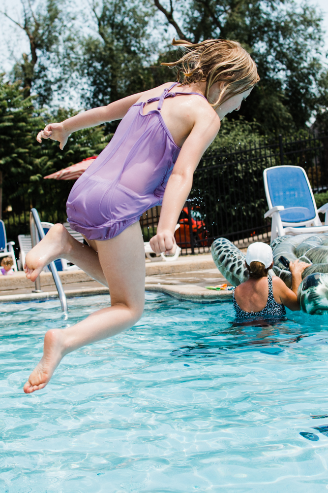 This girl fearlessly jumps into the water time and time again. She does amazing belly flops and they never hurt her.