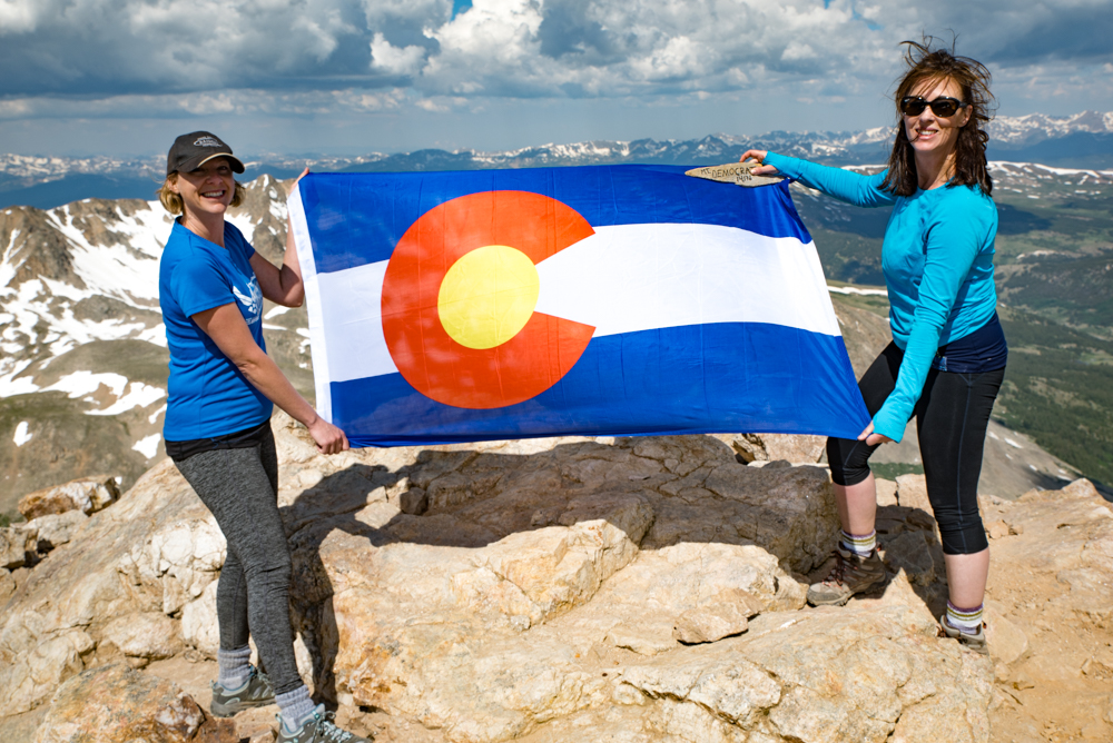 Just two Colorado native girls showing a little pride and me my white Irish legs. Also, my hair style is called 14,128ft. Eat your heart out!