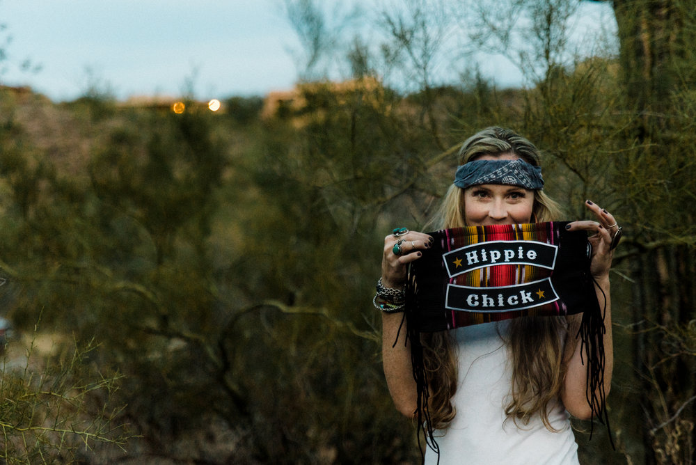 Beautiful Cortney owner of Hippie Momma Bags showing a black hippie chick bag in the Arizona desert