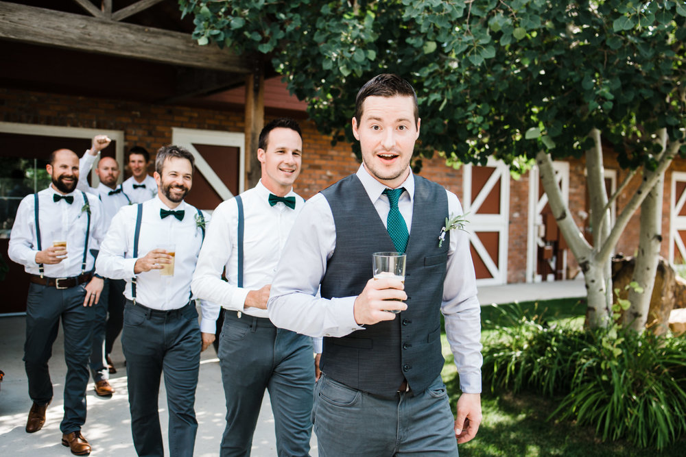 Colorado mountain wedding photographer at Brookeside Gardens groomsmen headed down the aisle