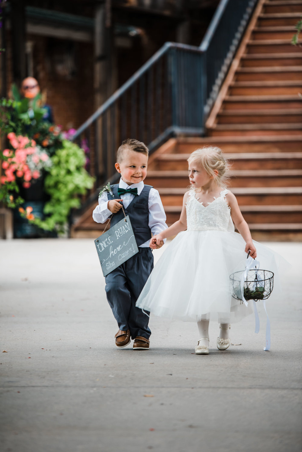 Colorado mountain wedding photographer at Brookeside Gardens flower girl and ring bearer headed down the aisle