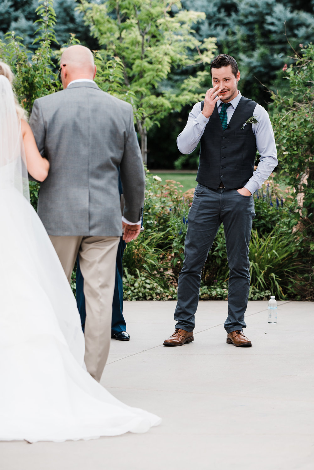 Colorado mountain wedding photographer at Brookeside Gardens groom first look