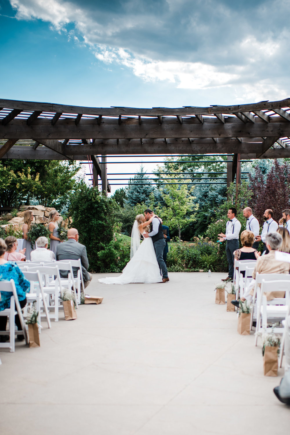 Colorado mountain wedding photographer at Brookeside Gardens wedding ceremony first kiss