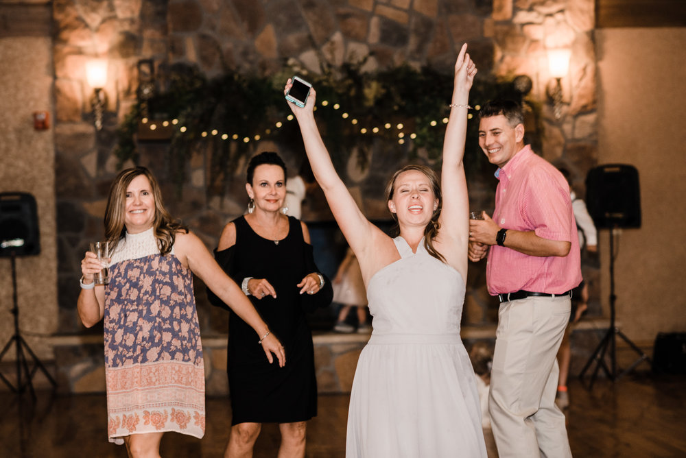 Colorado mountain wedding photographer at Brookeside Gardens wedding reception people dancing and having a good time