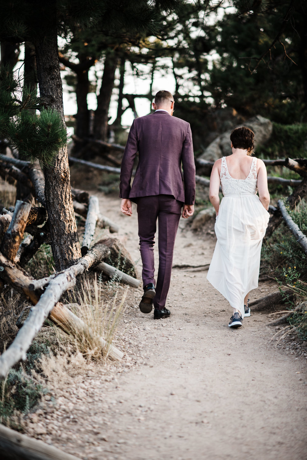Boulder Colorado elopement bride and groom walking