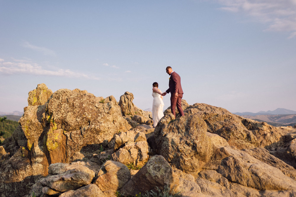 Boulder Colorado elopement bride and groom climbing on rocks