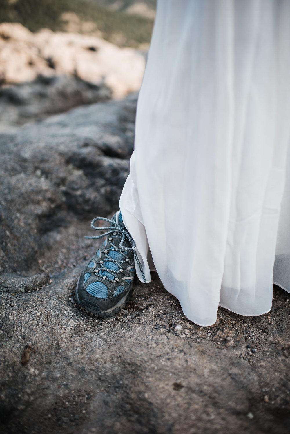 Boulder Colorado sunrise adventure elopement on cliff with hiking boots