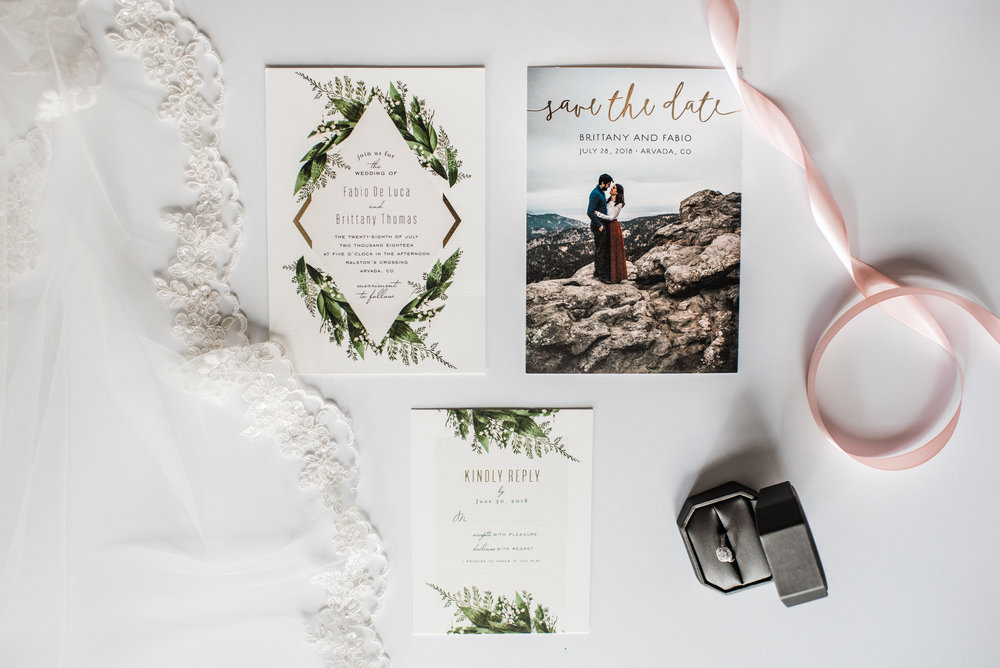 Wedding invitations of a stunning Colorado mountain wedding photographer