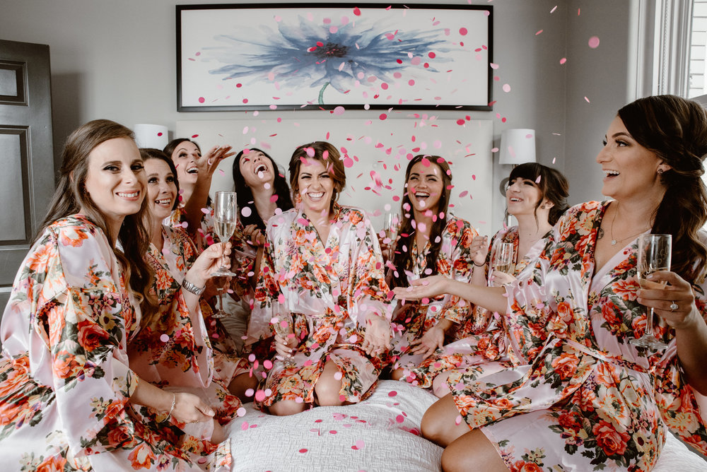 Bride and bridesmaids celebrating wedding in Colorado mountain wedding photographer