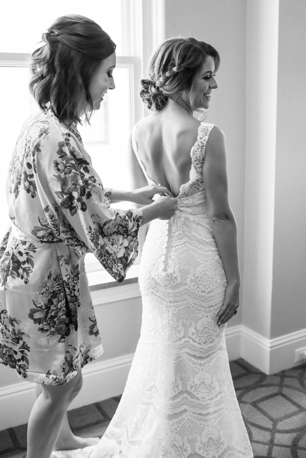 Bride getting into her dress at Colorado mountain wedding photographer