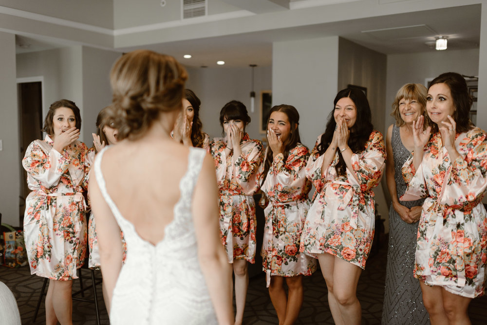 First look with bridesmaids at Colorado mountain wedding photographer