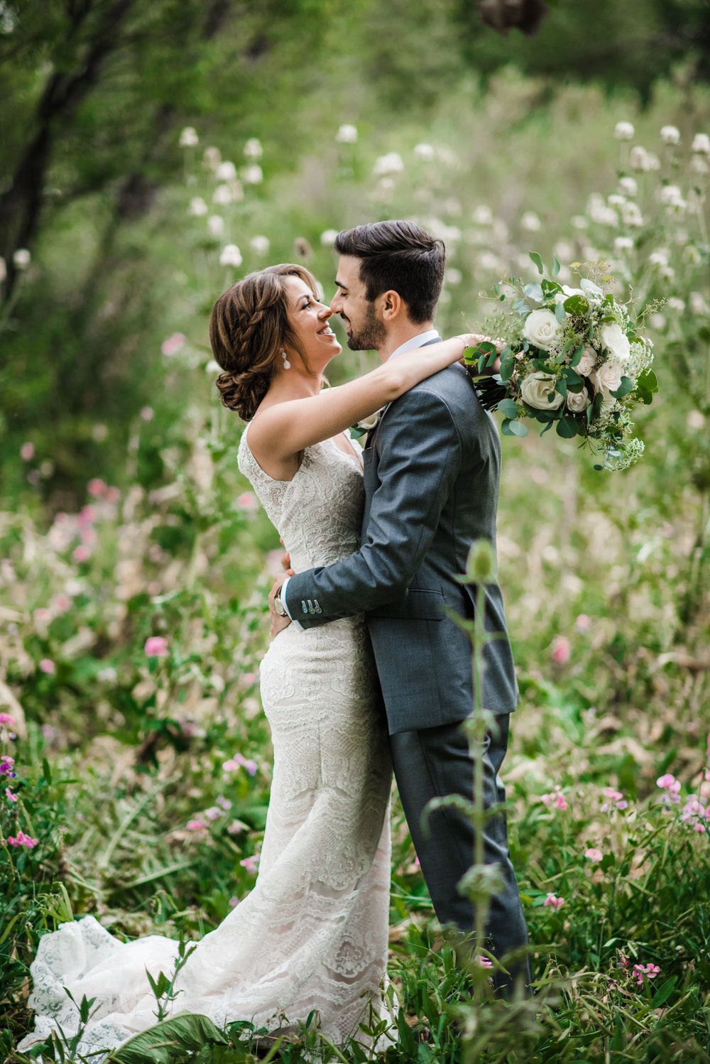 Bride and groom madly in love at spirited, genuine, colorful Colorado mountain wedding photographer