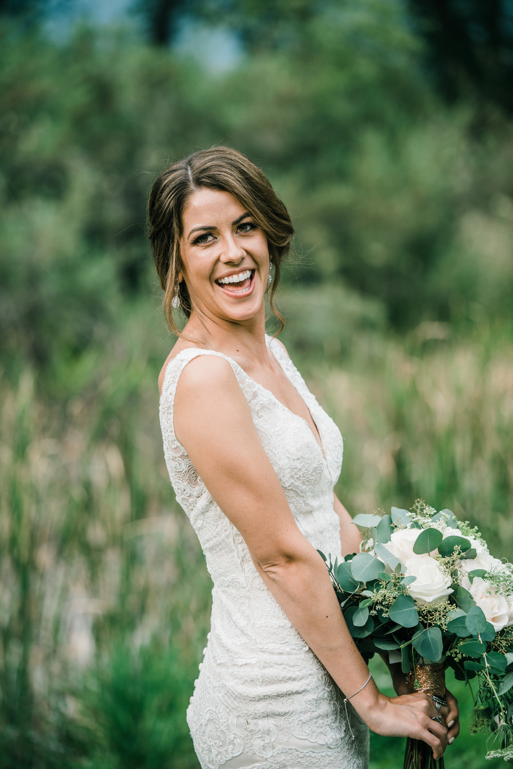 Bride at spirited, genuine, colorful Colorado mountain wedding photographer