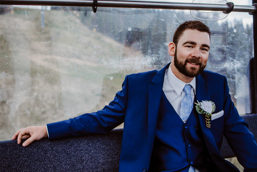 Groom on gondola at Keystone, Colorado mountain wedding