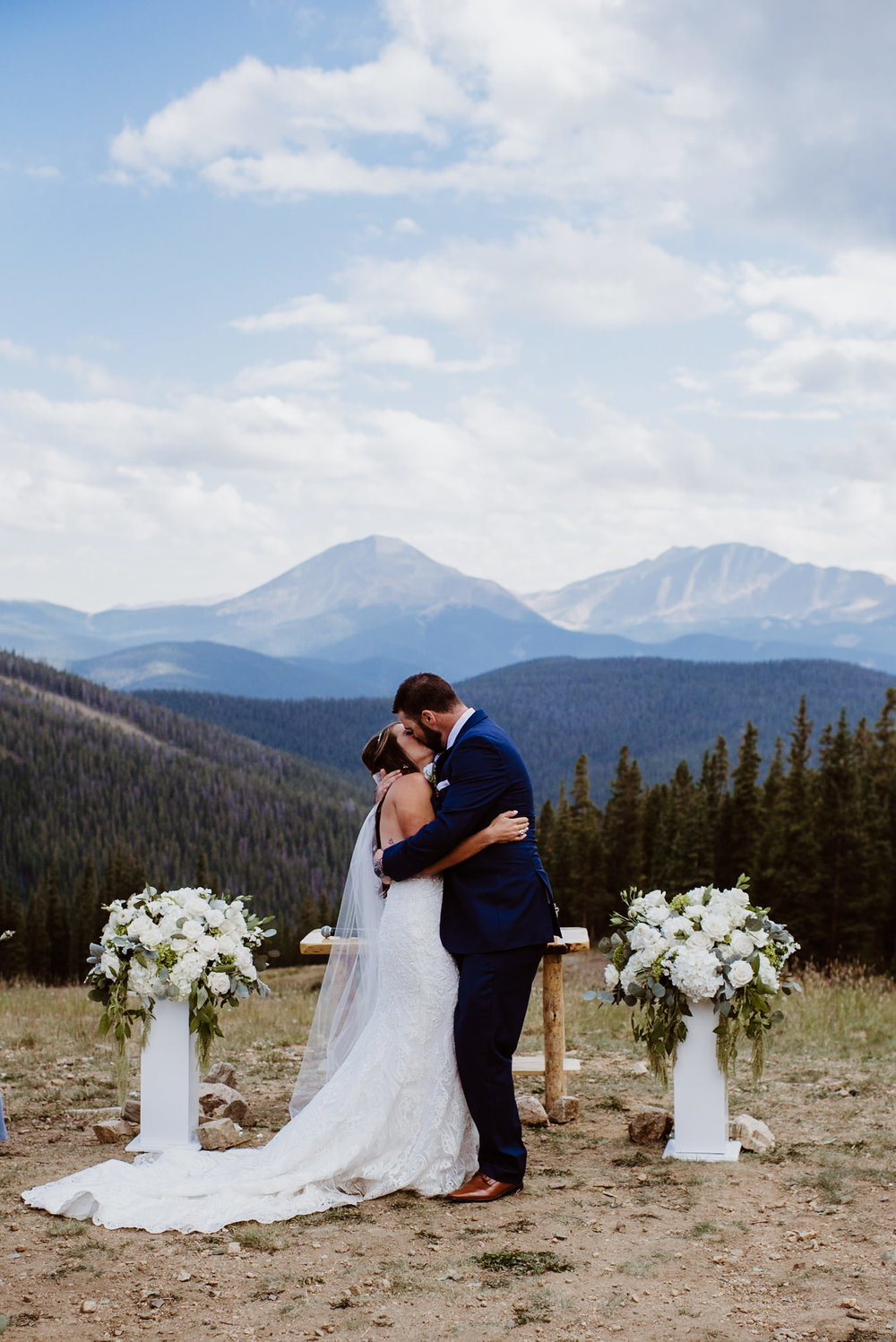 First kiss at TImber Ridge at Keystone, Colorado mountain wedding
