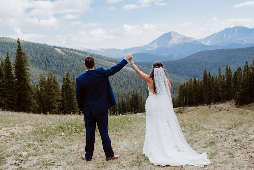 Bride and Groom at ceremony at TImber Ridge at Keystone, Colorado mountain wedding